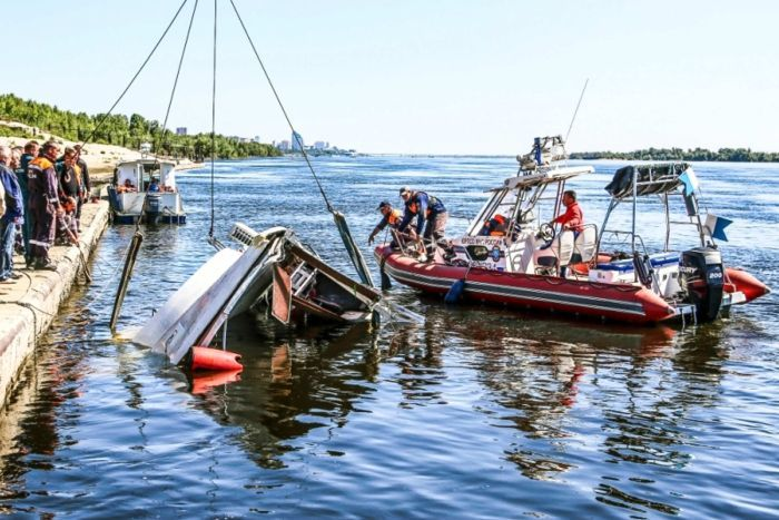 Emergency services attend to overturned boat in Russia