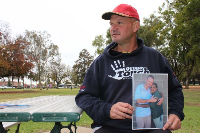 Dubbo resident Troy Parmount holds picture of deceased girlfriend Darlene Smith