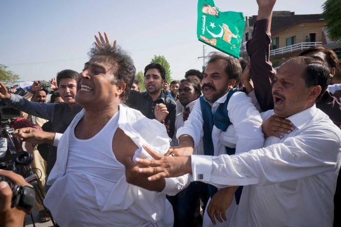 Supporters of former Pakistani Prime Minister Nawaz Sharif react outside a court