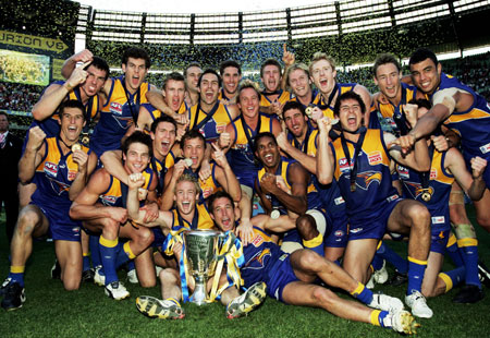 Sweet victory ... The Eagles celebrate their premiership win . ABC News Online