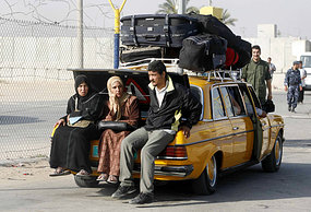 Palestinians wait to pass through the Rafah border in the southern Gaza strip. (File photo)