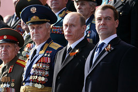Russian President Dmitry Medvedev and Prime Minister Vladimir Putin attend a Victory Day Parade