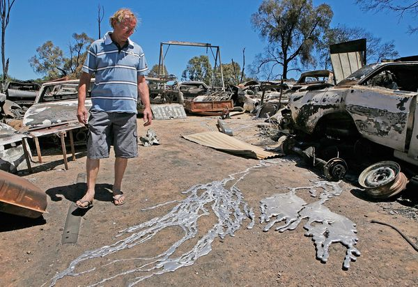 Craig Kidd looks at the melted metal of alloy wheels from the vehicles on his property in Bendigo
