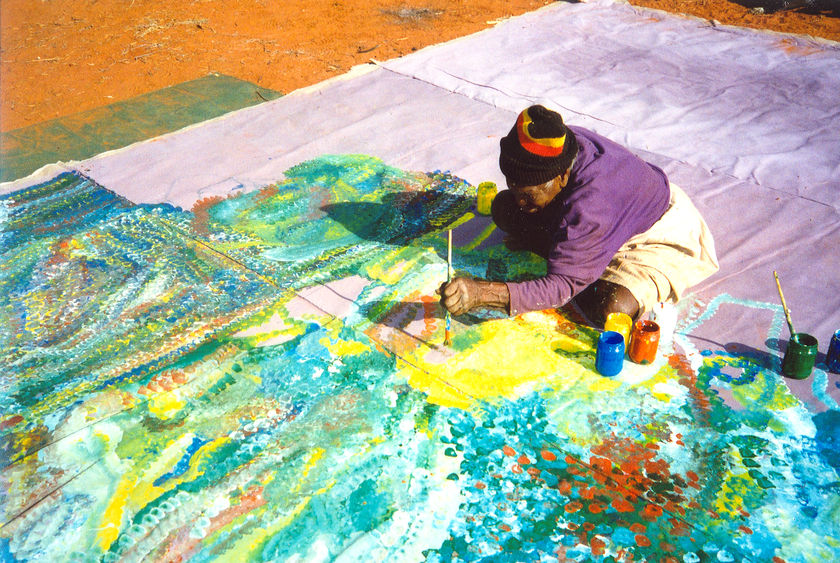 Emily Kngwarreye paints Earth's Creation. (Supplied)