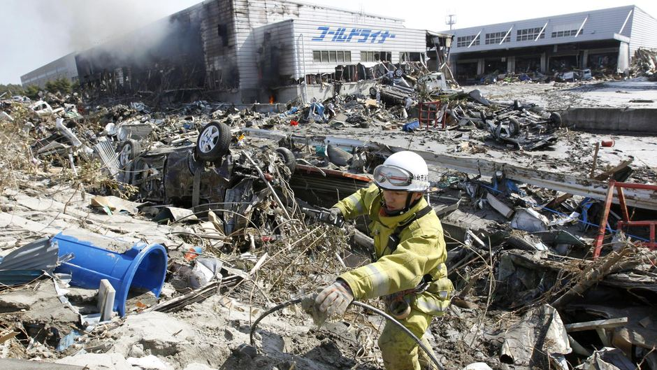 Factory burns in quake aftermath