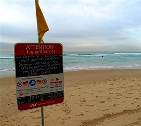 Surf beach sign warning of rips