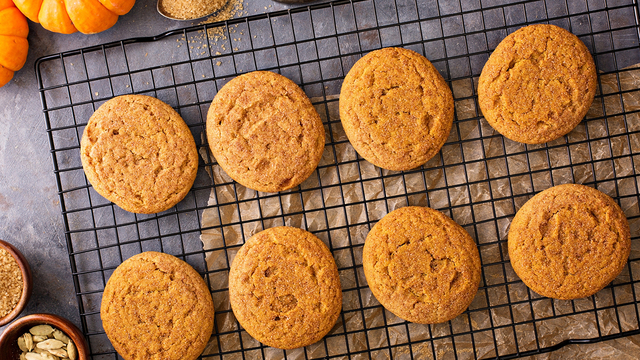 Fall snickerdoodle cookies with pumpkin and cinnamon overhead shot_629597