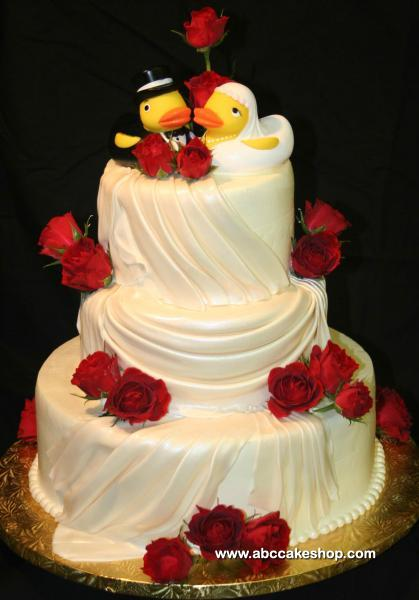Wedding cake with rubber ducky cake toppers  ABC Cake Shop  Bakery