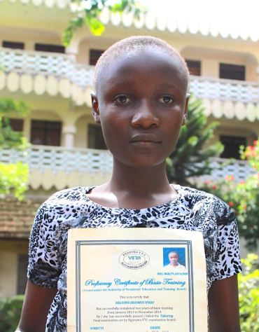 Delivina and her certificate