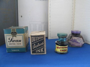 Four interesting old  ink bottles, a Swan Green writing fluid in box and Unopened,   A  Stephens Ink in box and unopened,  Watermans Ideal Ink which I don't think as ever been used and a Watermans empty ink bottle.  £25-00 for four.  Code Oc85