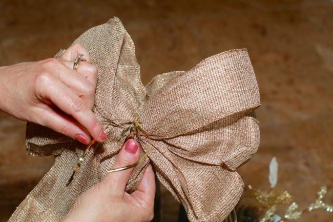 gold bow for winter holiday gift basket