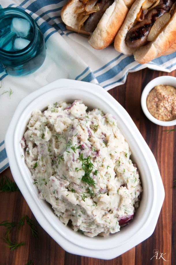 Fresh Dill and Red Potato Salad with mustard, hot dogs and blue glass