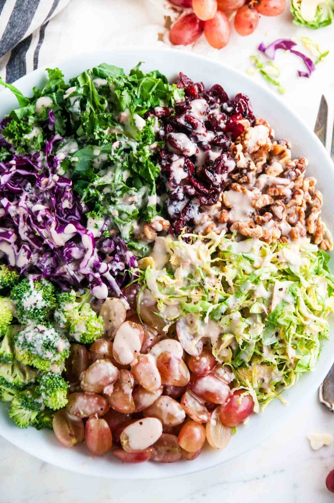 Chopped Brussel Sprout Kale Salad with Creamy Pomegranate Vinaigrette | aberdeenskitchen.com