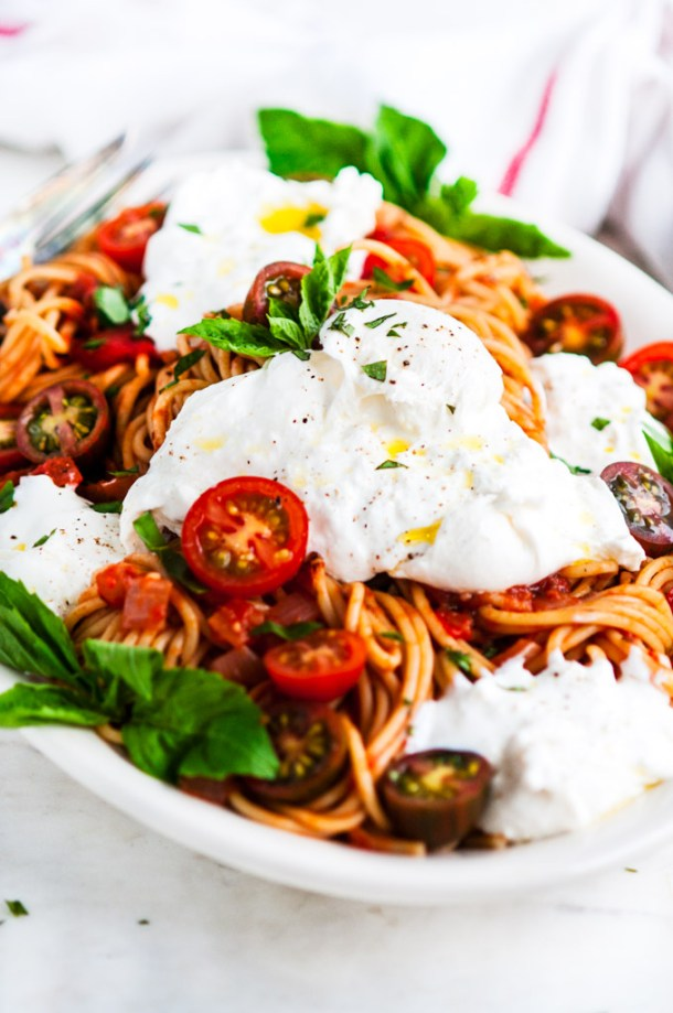 Tomato Basil Spaghetti with Burrata Close Up on a Serving Platter