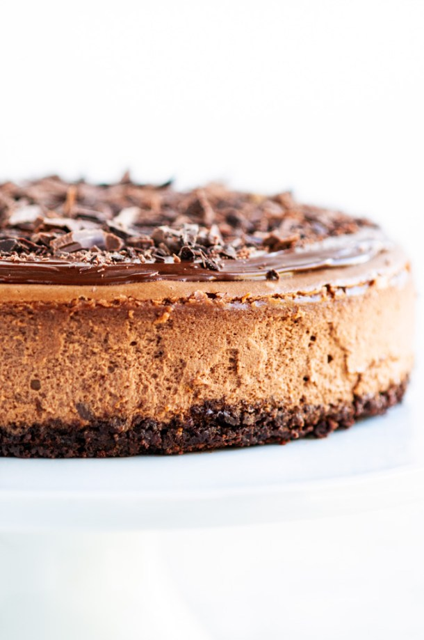 Triple Chocolate Cheesecake with ganache and chocolate shavings side close up