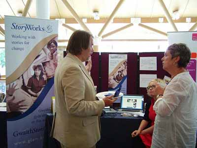 Storyworks stand with Lisa Heledd and Gilly Adams chatting with Joe Lambert of CDS