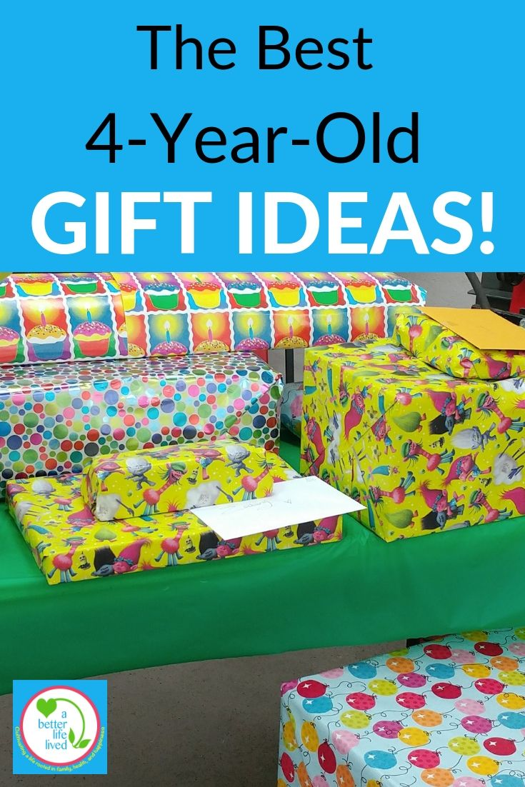 Gifts on table for child with Text overlay: The Best 4-Year-Old Gift Ideas!