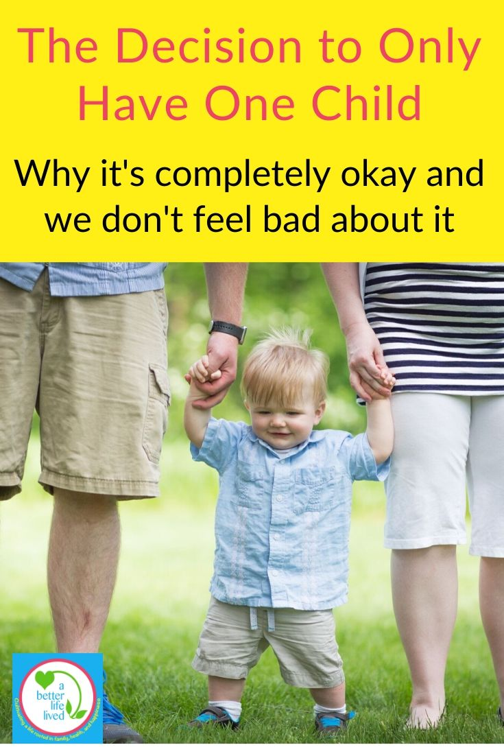 """two parents holding young child's hand outside with text overlay """"the decision to only have one child Why it's completely okay and we don't feel bad about it"""""""