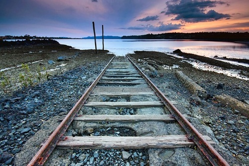 Train track end at sea