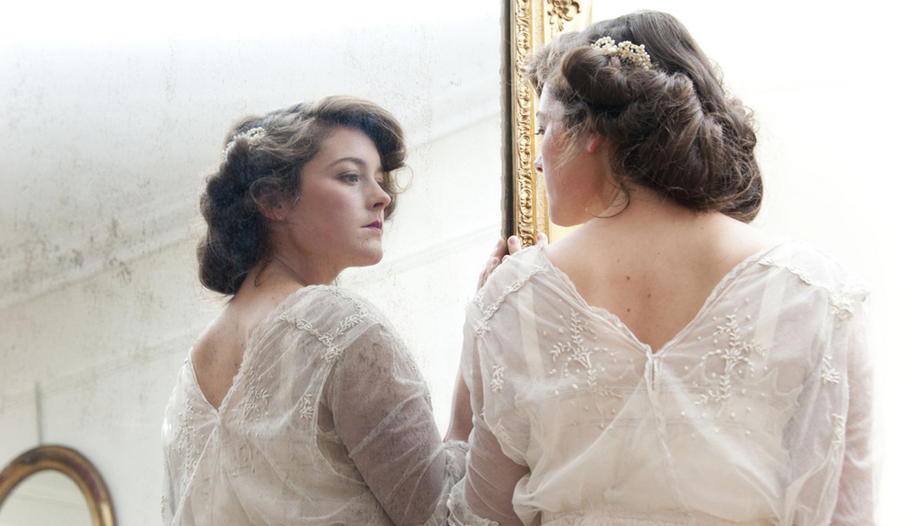Edwardian net lace with tabard bodice and sprig embroidery..