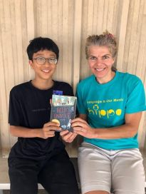 Mother and son holding book