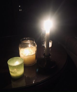 Candles burning in dark power outage