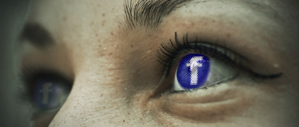 facebook icon in woman's eye
