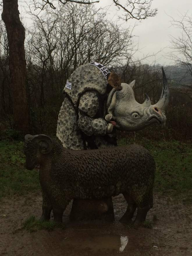 pic of jim in rhino costume with sheep statue