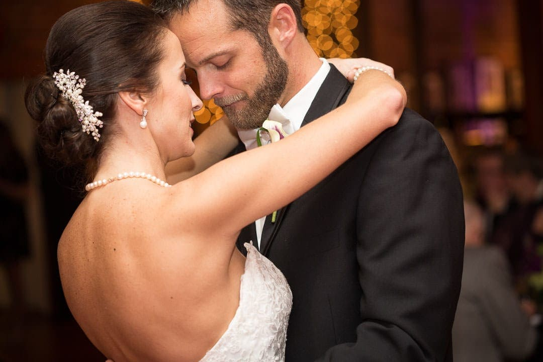 close up of the bride and groom during the first dance showing warm skintones