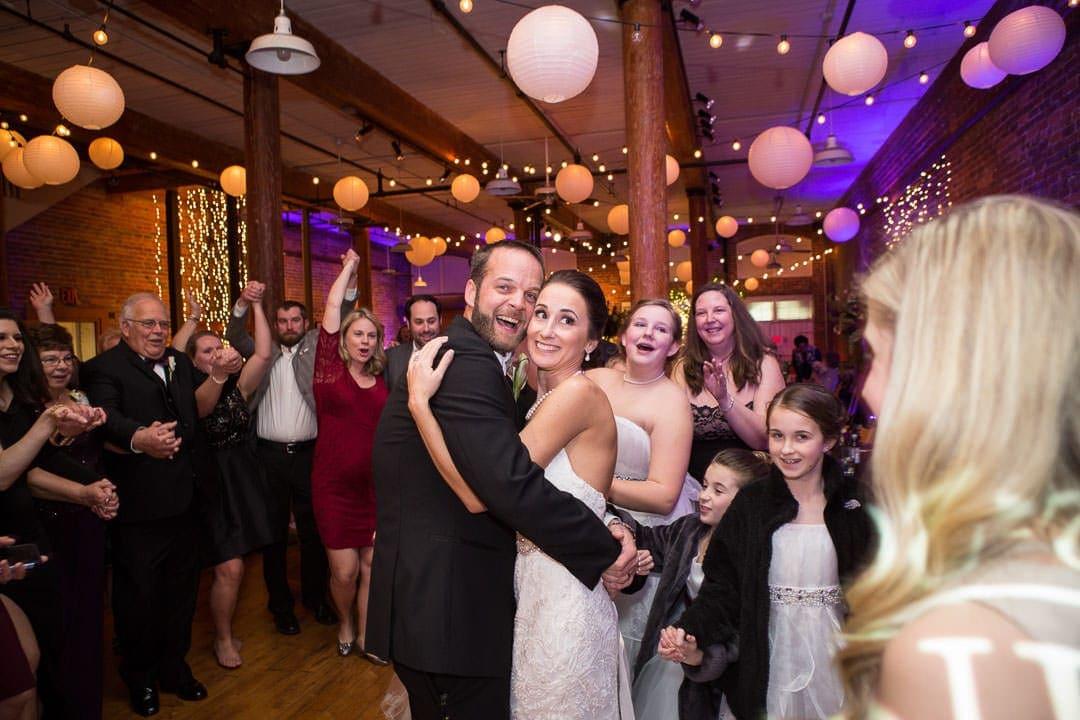 bride and groom on dance floor at their city art wedding reception