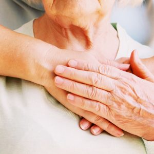 Young female hands hugging old woman, closeup
