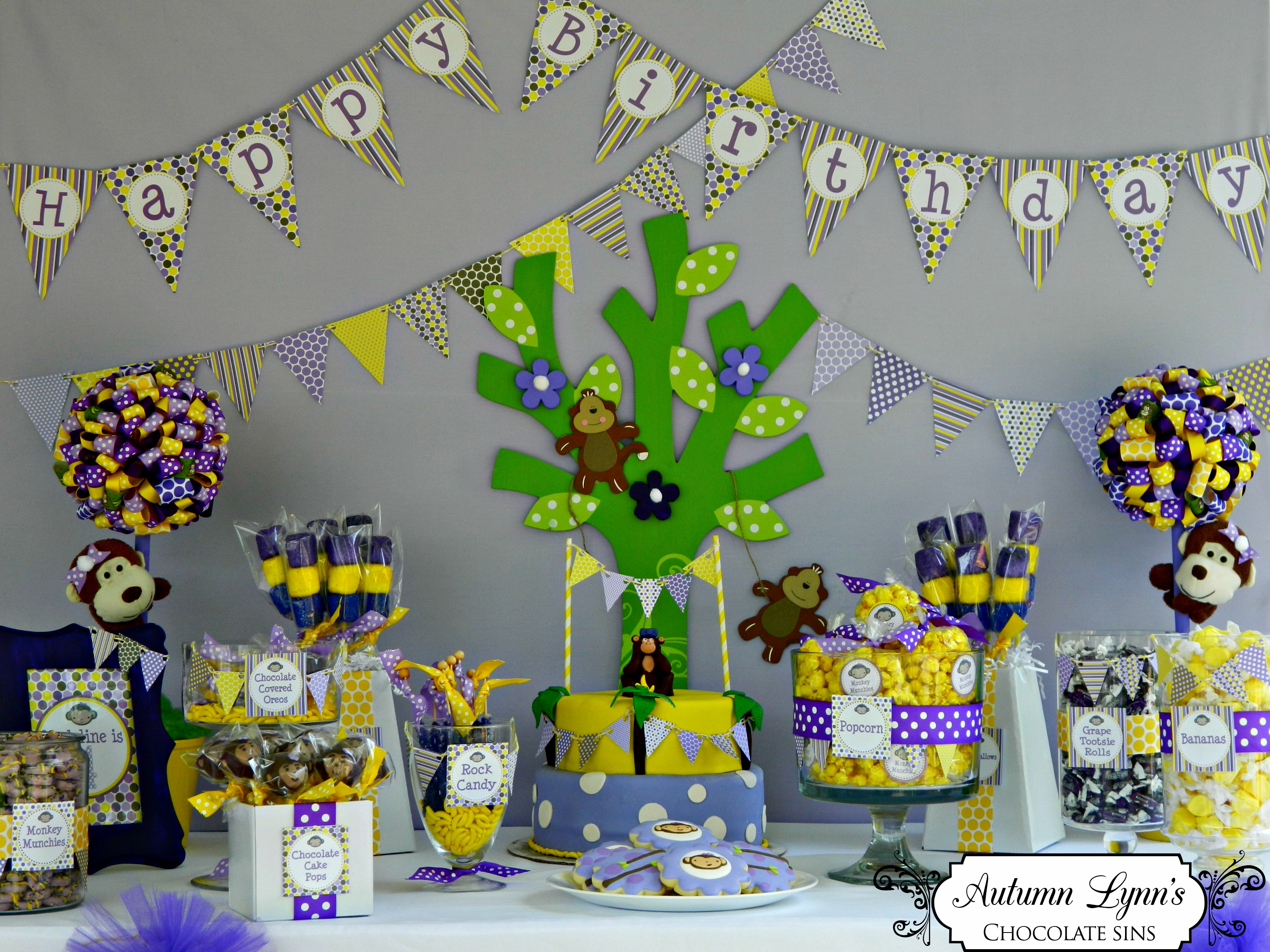 purple and yellow monkey party table