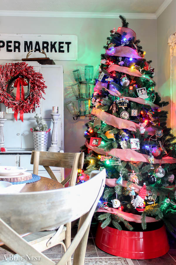 A nostalgic Christmas dining room featuring vintage colored lights and whimsical touches.