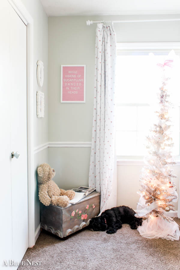 A little girl's Christmas bedroom complete with soft colors and a nutcracker theme.