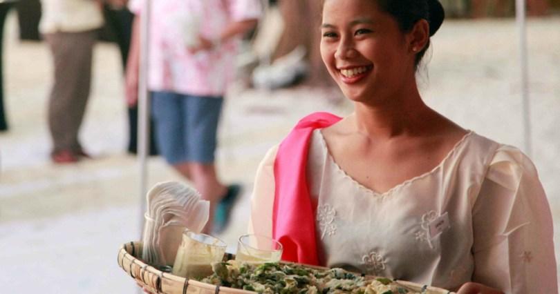Filipina Carrying a Bilao