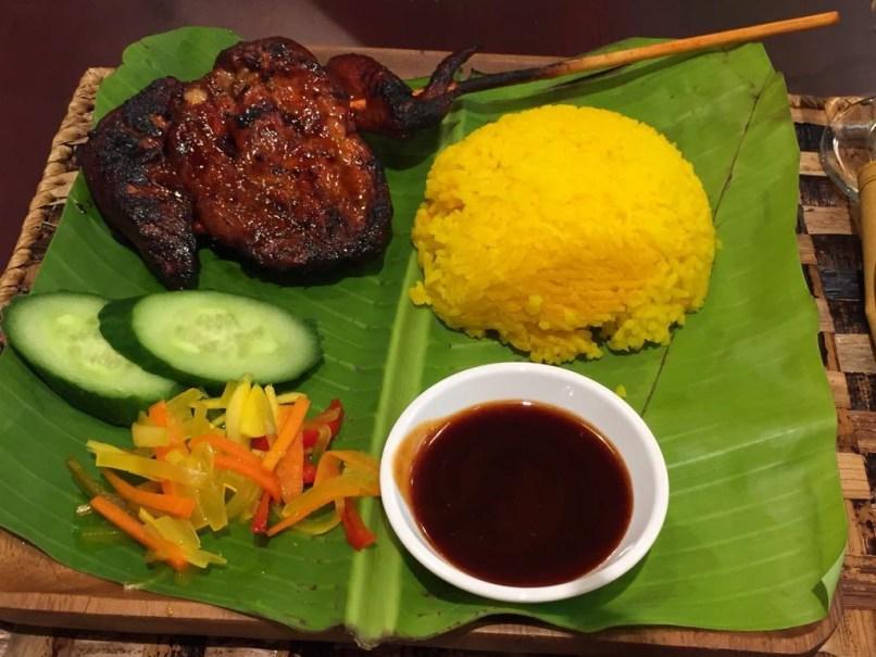 Java Rice & BBQ meal on banana leaf