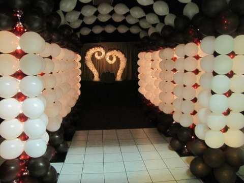 A grand illuminated tunnel entrance says fun is ahead