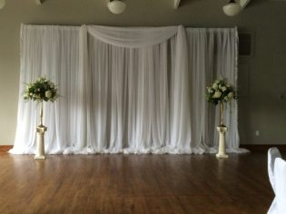 Luxurious white sateen and sheer fabric can add elegance to any room.