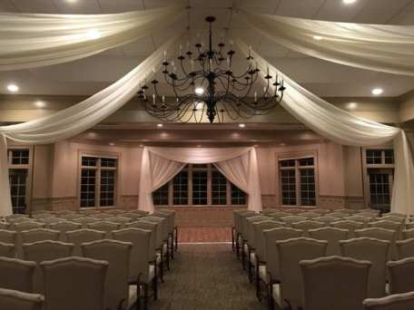 Draping fabric adds class and elegance to ceremonies and receptions. Design by Above the Rest Event Designs.