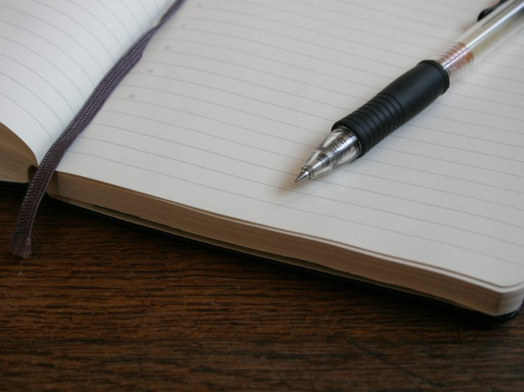 Pen on lined notebook