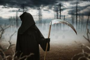 Death with a scythe in the dark misty forest