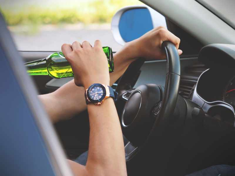 Underage male drinking alcohol while driving a vechile