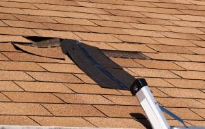 slope roof shingle damage