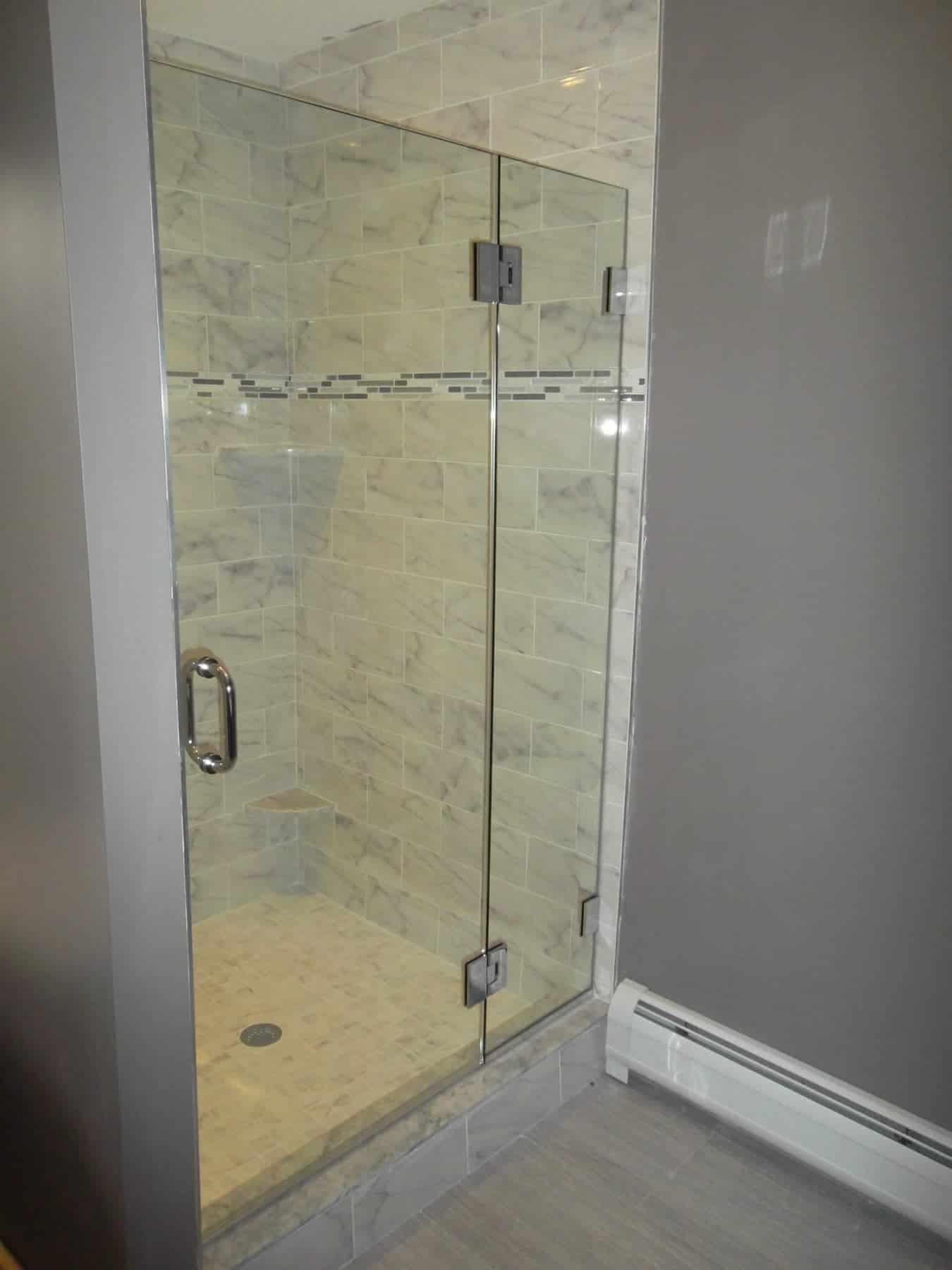 Frameless Shower Enclosure Door Hinging Off Of Panel
