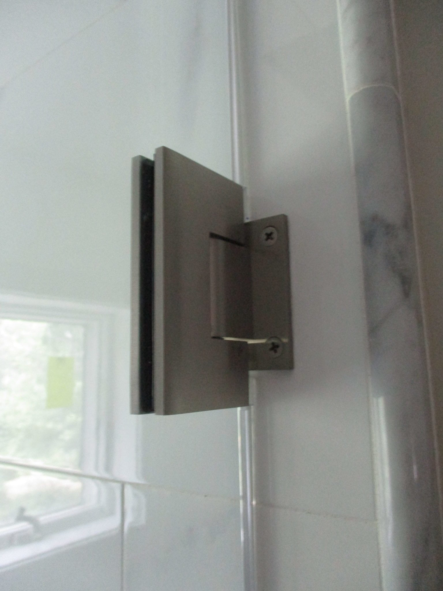Wall mount hinges in brushed nickel.