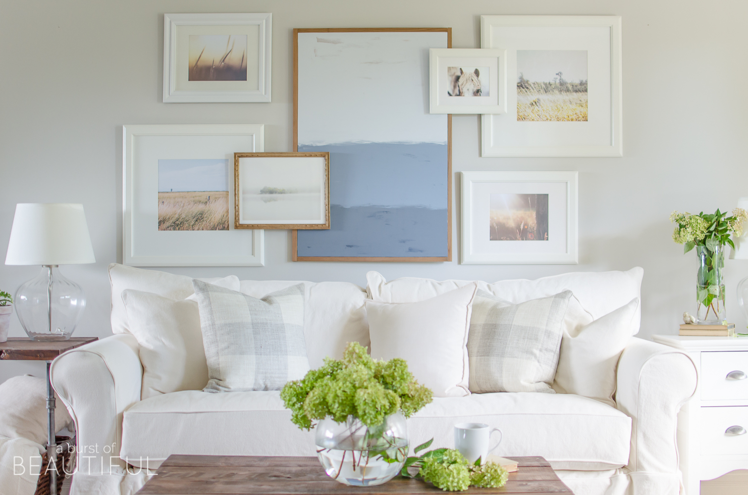 white slipcovered sofa living room country style chairs why we chose a burst of beautiful looks casual and relaxed in this charming farmhouse learn