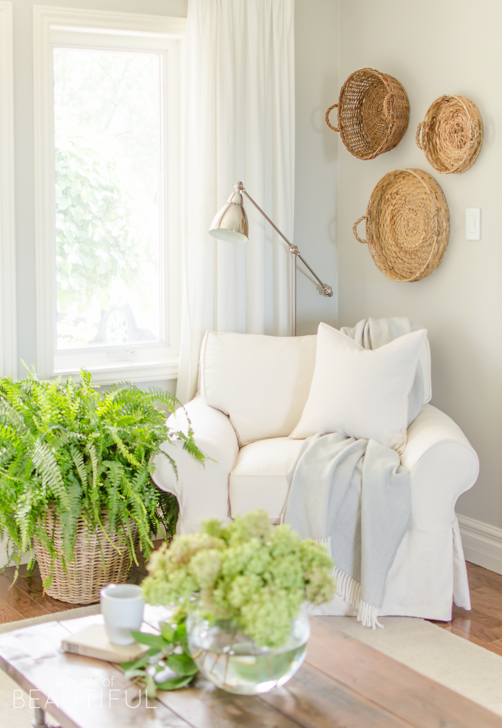 white slipcovered sofa living room amazon curtains why we chose a burst of beautiful looks casual and relaxed in this charming farmhouse learn