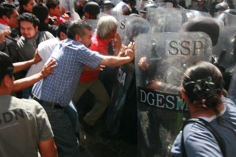 Calderon visita Oaxaca para reprimir