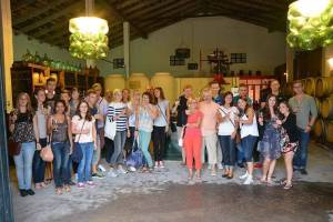Group of language students at a wine tasting session at a local winery ¡Salud!
