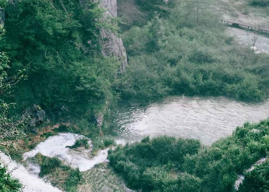 rapid waterfall on high mount near pond